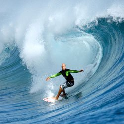 "Promotional image of Kelly Slater surfing from the IMAX film ""The Ultimate Wave Tahiti,"" playing at the Reuben H. Fleet Science Center."