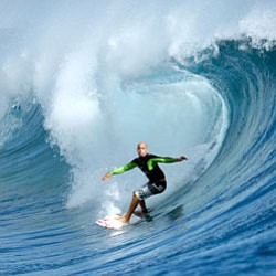 Promotional image of Kelly Slater surfing from the IMAX f...