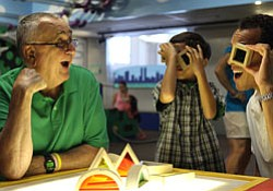 """A family having fun with science at the """"Kid City"""" exhibi..."""