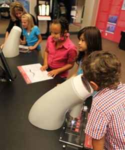 Kids having fun with science at the Reuben H. Fleet Science Center.