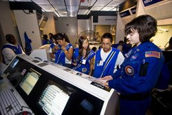 Guest having fun with science in the Nierman Challenger Learning Center at the Reuben H. Fleet Science Center.