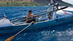 Photo of Roz Savage in her rowboat on the ocean. Savage is a British ocean rower, author, motivational speaker, environmental campaigner and earlier this year became the first woman to row solo across the Pacific Ocean.
