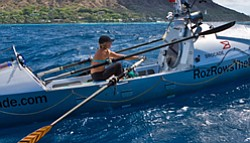 Photo of Roz Savage in her rowboat on the ocean. Savage i...