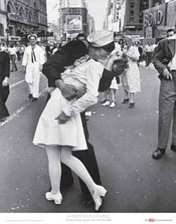 "Edith Shain photographed being kissed by a joyous sailor in Times Square on August 14, 1945, that inspired the statue ""Unconditional Surrender"" that stands in front of the Midway."