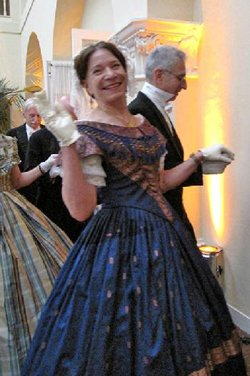 Two Viennese Nights party goers pose for the camera.