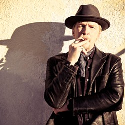 Promotional photo of Dave Alvin. Photo courtesy of Beth Herzhaft.
