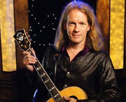 Billy McLaughlin with guitar in the KPBS studio. Photo courtesy of Roland Lizarondo for KPBS.