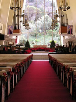 Interior image of First United Methodist Church sanctuary decorated for the holidays.