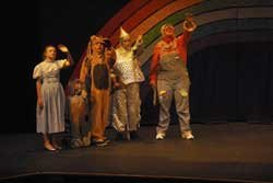 """Promotional photo of actors on stage for the production of """"The Wizard of Oz,"""" presented by Missoula Children's Theatre. Conceived and Written by Jim Caron. Music & Lyrics by Michael McGill, Bob Hubley & David W. Simmons"""