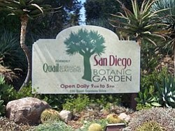 San Diego Botanic Garden Entrance Sign: Open daily from 9 a.m. to 5 p.m., located at 230 Quail Gardens Drive.