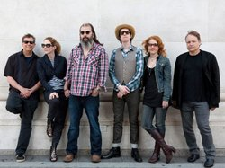 Promotional photo of Steve Earl with his electric live band, The Dukes (and Duchesses) featuring Allison Moorer.