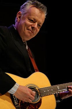 "Guitar virtuoso Tommy Emmanuel performing on stage during the taping of ""Tommy Emmanuel And Friends: Live From The Balboa Theatre,"" San Diego, February 2011. Photo by Andy Trimlett for KPBS."