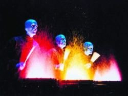 Image of a Blue Man Group performance.