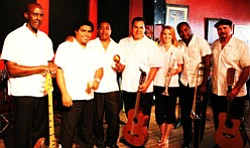 Promotional photo of the members of Combo Libertad. Combo Libertad utilizes traditional instruments including the Tres, Tresillo, Congas, Timbales, Trumpet, Trombone and Bass.