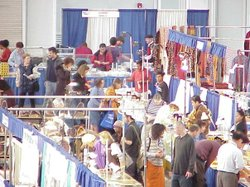 Promotional photo of patrons at a Gem Faire event, a world-renowned marketplace for the finest in gemstones, beads, jewelry, minerals, fossils, meteorites, lapidary equipment and metaphysical items.
