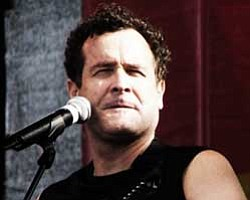 Promotional photo of Johnny Clegg, singer, songwriter, dancer, anthropologist and musical activist