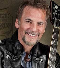 Promotional photo of singer, songwriter, and guitarist Kenny Loggins