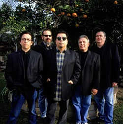 Promotional photo of Los Lobos.