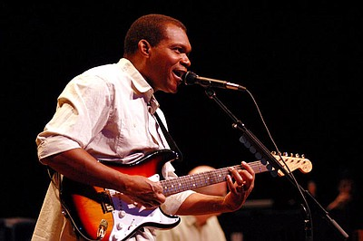 Promotional photo of blues guitarist, Robert Cray.