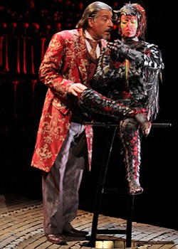 "Performance photo of Max McLean & Karen Eleanor Wight from ""The Screwtape Letters."""
