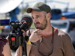 """Graphic of Sean Casey, IMAX filmmaker and star in the Discovery Channel reality series """"Storm Chasers,"""" by Ryan McGinnis."""