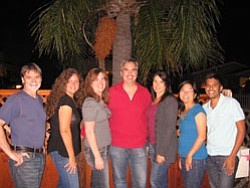 Promotional photo of the a cappella group, Singchronicity.
