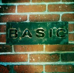 Promotional image for BASIC, who will be hosting Deck the Walls: A Skateboard Deck Art Show on December 18th, 2012.