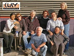 Promotional photo of some studio associates sitting for a picture. Clay Associates is committed to the advancement of ceramic arts through community involvement and education.