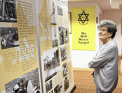 Promotional image of Courage to Remember traveling Holocaust exhibit in Florida.
