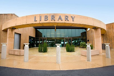 Exterior photo of the Encinitas Library, located at 540 C...