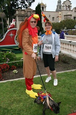 Promotional image of a couple participating in Father Joe's Villages Thanksgiving Day 5K.