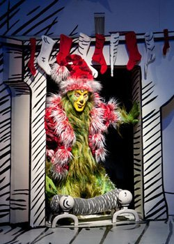 """Steve Blanchard stars as The Grinch in the 2011 production of """"Dr. Seuss' How the Grinch Stole Christmas!"""" at The Old Globe. The annual holiday musical runs November 17th - Dec. 29th 2012 with an autism-friendly performance on December 15th at 10:30 a.m. Photo by Henry DiRocco."""