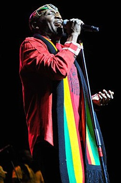 Image of Jimmy Cliff singing.