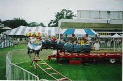 Promotional photo of family fun on a carnival ride at a Norris Amusement pumpkin patch. Courtesy of Norris Amusement