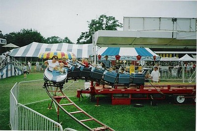 Promotional photo of family fun on a carnival ride at a N...