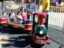Promotional photo of young guests taking an El Paso train ride at the Chula Vista Pumpkin Station. Courtesy of Pumpkin Station