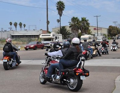 Image of motorcycles participating in Ride to the Races.