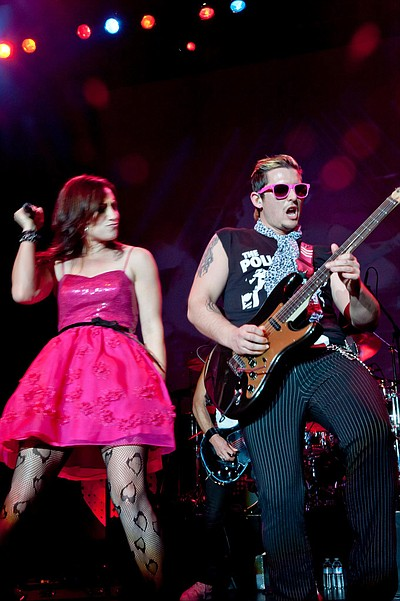 Promotional image of Tainted Love live in concert.