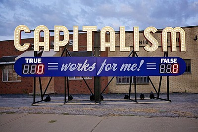 "Graphical logo for ""Capitalism Works for Me""."