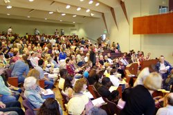 Image of people attending First Unitarian Universalist Church of San Diego's auditorium.