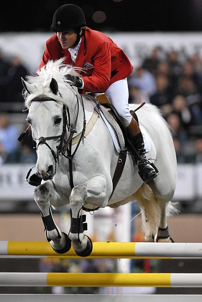 Show jumping or stadium jumping is characterized by a cou...