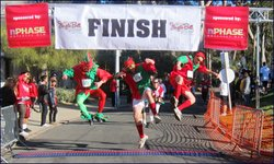 """Image from a previous year of the """"Jingle Bell Run/Walk"""" for Arthritis finish line."""