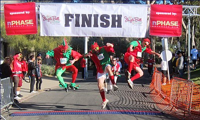 "Image from a previous year of the ""Jingle Bell Run/Walk"" for Arthritis finish line."