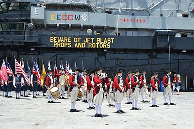 Promotional image of Flag Day Celebration on the USS Midway.
