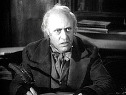 Promotional image of Ebenezer Scrooge played by Alastair Sim.