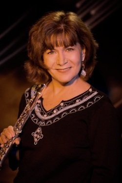 Image of flutist, Lori Bell, who will be performing at The Cosmo on Saturday, January 12th, 2013. Photo by Michael Oletta.