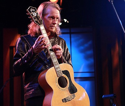 Billy McLaughlin plays his guitar. (Photo by KPBS )