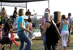 Image of attendees from a previous year of the Bird Park Summer Concert Series.