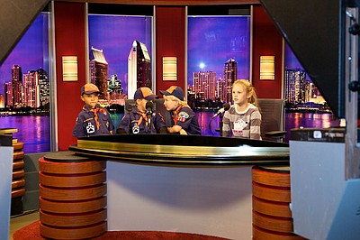 Some children trying out the KPBS Evening Edition set.