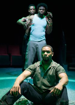 """Joshua Elijah Reese as Ogun Henri Size (foreground) and (background, from left) Antwayn Hopper as Elegba and Okieriete Onaodowan as Oshoosi Size in the Southern California premiere of Tarell Alvin McCraney's """"The Brothers Size,"""" directed by Tea Alagić, Jan. 26 - Feb. 24, 2013 at The Old Globe. Photo by Henry DiRocco."""